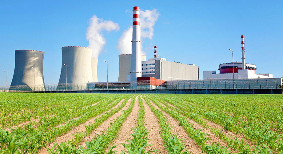 Nuclear power plant with green corn field
