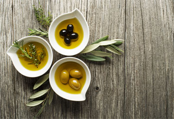 Olives and herbs in serving dishes